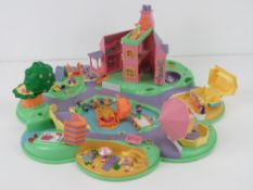 Polly Pocket; c1990s being a cluster of houses inc lake with treasure island, beach, stables,
