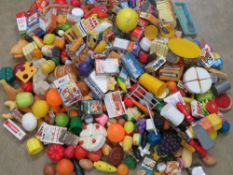 An extensive collection of shop or playhouse plastic food together with shopping baskets,
