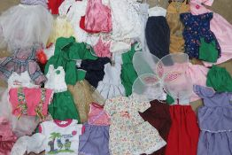 A large quantity of handmade dolls clothes for 'lifesize' doll.