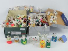 101 Dalmations; a large quantity of Disney figurines in various amusing poses.