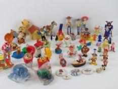 A quantity of assorted Disney, McDonald's, Burger King toys including Coca Cola bears,
