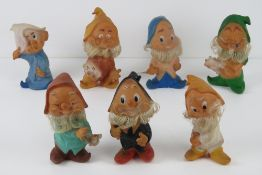 A set of seven 20th Century dwarves from Disney's Snow White, no apparent makers marks,