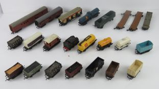 A quantity of Triang Hornby model railway goods carriages inc R117 Shell tanker and two other Shell