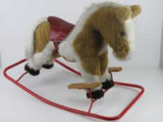 A rocking horse by Nylena having leatherette saddle and having been known as Sherbert for the past