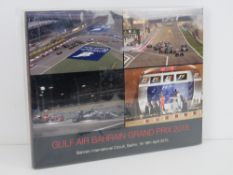 Gulf Air Bahrain Grand Prix 2015, hardback book of event photographs. In plastic wrap.