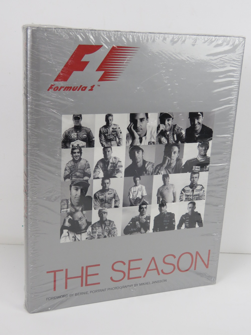 F1 The Season, 2003 edition with foreword by Bernie, portrait photography by Mikael Jansson.