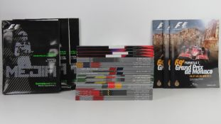A large quantity of assorted Formula 1 race programmes for 2011 and 2012.