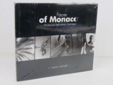 Faces of Monaco Photos by Sebastien Darrasse. Published 2004. Hardback book. In plastic wrap.