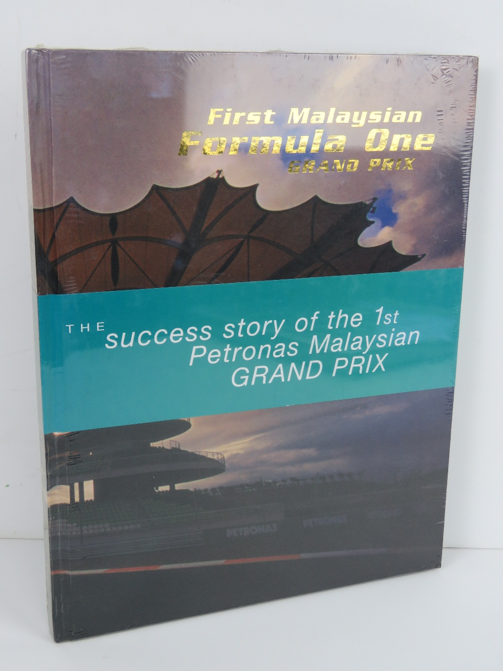 The Success Story of the 1st Petronas Malaysian Grand Prix. Hardback book. In plastic wrap.
