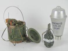 Three inert items; F1 Limonka grenade,