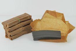 Five unissued M16 30 round magazines.