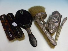 A GROUP OF SILVER AND TORTOISE SHELL MOUNTED DRESSING TABLE ITEMS.