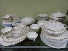 A DOULTON RICHELIEU PATTERN DINNER SERVICE, EACH PIECE GILT WITH A WAVY FOLIAGE RIMS BAND,