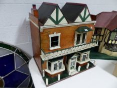 A VINTAGE PAINTED DOLL'S HOUSE, DOUBLE GABLE ROOF ABOVE BALCONY AND TWO BAY WINDOWS. W.67 x H.