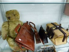 A LARGE VINTAGE PLUSH TEDDY BEAR TOGETHER WITH VARIOUS HANDBAGS.