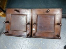 A PAIR OF ANTIQUE OAK FIVE PEG COAT RACKS WITH PANEL BACKS. (2)