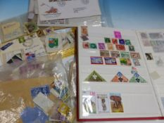AN ALBUM OF 20th C. WORLD STAMPS, OTHERS LOOSE AND A SMALL QUANTITY OF FIRST DAY COVERS.