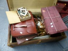 A VINTAGE TRUNK CONTAINING VARIOUS GAMES, TOYS, HANDBAGS, ETC TO INCLUDE A MAZDA SET OF DISNEY