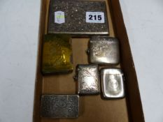 THREE SILVER VESTAS, ANOTHER IN WHITE METAL, A BRASS MATCHBOX SLEEVE AND A SILVER VISITING CARD