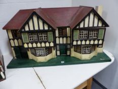 A LARGE PAINTED TUDOR STYLE DOUBLE FRONTED DOLL'S HOUSE WITH PINE TABLE/STAND. HOUSE W.120 x H.