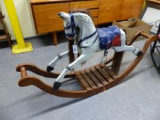 A SMALL ROCKING HORSE ON LONG CURVED ROCKERS.