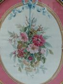 AN ANTIQUE OVAL AUBUSSON TAPESTRY PANEL OF A HANGING FLORAL BOUQUET IN GILT FRAME. 95 x 76cms.