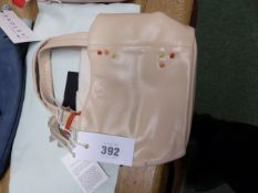 A RADLEY PALE PINK LEATHER BAG SEWN WITH OCHRE, RUSSET AND GREEN KNOTS TO ONE SIDE, THE SCOTTIE