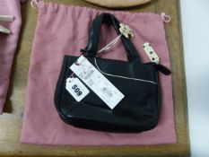 A RADLEY BLACK LEATHER HANDBAG WITH WHITE POLKA DOT ZIP PULL AND LINING TOGETHER WITH A PINK TEXTILE
