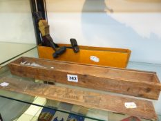 A VINTAGE ANGLING GAME IN WOODEN BOX TOGETHER WITH A WOODEN TOY FIGURE. (2)