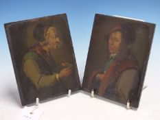 A PAIR OF LOW COUNTRIES PORTRAITS OF MEDIAEVAL MEN, OIL ON WOODEN PANELS. 14 x 11cms.