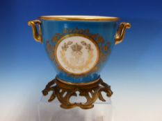 A SEVRES TWO HANDLED BLUE GROUND CACHE POT WITH ROCOCO ORMOLU FOOT AND ONE SIDE PAINTED WITH THE