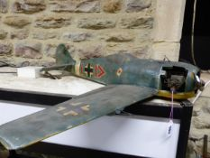 A GERMAN WORLD WAR II MODEL FIGHTER PLANE WITH FUEL DRIVEN ENGINE, THE WINGS. W 85cms.