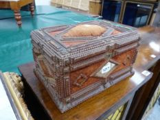 A TRAMP ART CASKET, THE CHIP CARVED WOOD WORK EDGING BROWN VELVET, THE FRONT AND BACK WITH CENTRAL