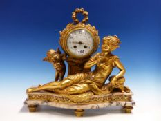 A GILT METAL CLOCK GARNITURE FORMED OF A PAIR OF TWO HANDLED URNS AND COVERS, THE CYLINDRICAL