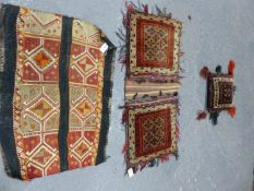 TWO BELOUCH TRIBAL SADDLE BAGS. AND A FLAT WEAVE PANEL. (3)