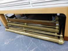 THREE ANTIQUE BRASS RAIL TOP FIRE CURBS AND A BRASS MOUNTED OAK FIRE CURB. (4)