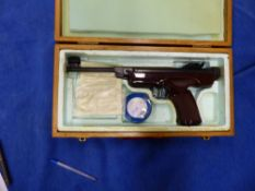 A BOXED GERMAN ORIGINAL AIR PISTOL CAL 5.5/.22 WITH ADJUSTABLE SIGHTS AND BROWN PLASTIC GRIP.