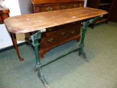 AN ANTIQUE PAINTED CAST IRON BASED GARDEN TABLE WITH RECTANGULAR TOP. W.102cms.