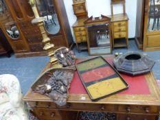 TWO ANTIQUE WALL BRACKETS DECORATED WITH LEATHER FRUIT, A TOLEWARE WALL CLOCK CASE, A GILTWOOD TABLE