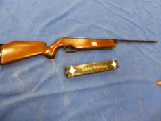 A NORICA 80G BREAK BARREL .177 AIR RIFLE SERIAL NUMBER 106002 AND A NIKKO STIRLING 4 X 15 SCOPE.