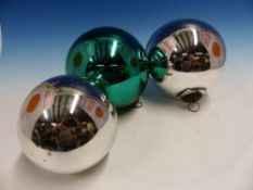 THREE FRENCH VERGO GLASS MIRRORED BAUBLES, TWO OF THE SPHERES SILVERED AND THE OTHER GREEN, THE