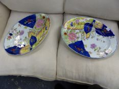 A PAIR OF OVAL PORCELAIN PLATTERS PAINTED WITH A TOBACCO LEAF PATTERN. W 50cms.