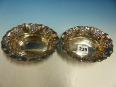 A PAIR OF HALLMARKED SILVER ART NOUVEAU SMALL DISHES.