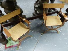 A PAIR OF CHILDREN'S GARDEN CHAIRS, THE DEAL BACKS, ARMS AND SEATS SUPPORTED ON IRON STRAPS WITH