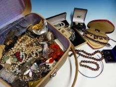 A SMALL SUITCASE OF COSTUME AND SILVER JEWELLERY.