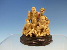 MITSUTAMA, AN IVORY OKIMONO OF GAMA SENNIN STANDING HOLDING A SCROLL AND A MINOGAME WHILE SINGING,