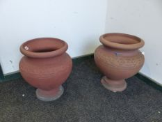 A PAIR OF HATHERN STATION CO. LTD. RED TERRACOTTA PLANTERS A CIRCULAR BAND OF FLOWER HEADS ON THE