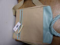 A RADLEY MUSHROOM AND SKY BLUE LEATHER SHOULDER BAG WITH CANVAS STRAP