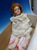 A SIMON AND HALBIG BISQUE HEADED DOLL WITH FIXED OPEN EYES AND MOUTH, HER NECK NUMBERED 10, HER