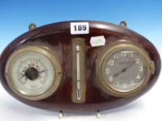 AN ARTHUR LAMBRECHT CLOCK, ANEROID BAROMETER AND THERMOMETER MOUNTED ON A MAHOGANY OVAL. W 30cms.